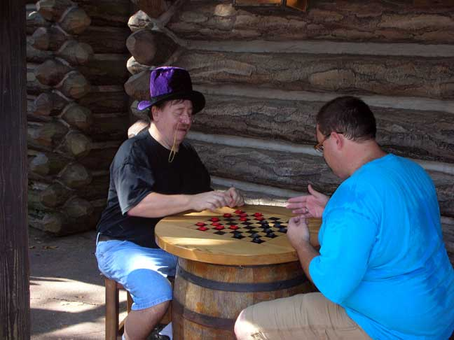 Dr. Ur-sella and his henchman playing checkers on Tom Sawyer Island