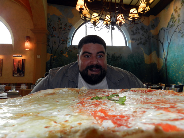 John can't wait to try the pizza.