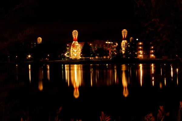 A nighttime view of Disney's Pop Century Resort's 1950's Building